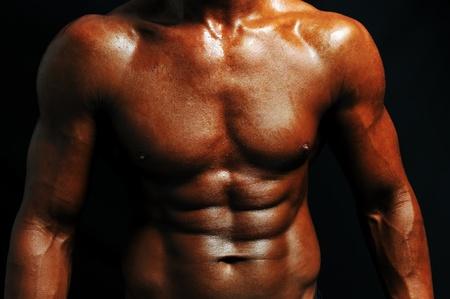 Bodybuilder strong as a rock photo
