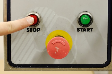 winepress: Finger pressing stop button Stock Photo