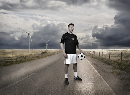 a football player standing on the road photo