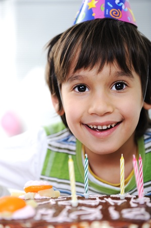 Boys with candles on cake, happy birthday party Stock Photo - 10316826