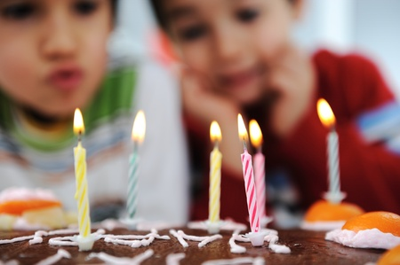 birthday cake: Two little boys blowing candles on cake, happy birthday party
