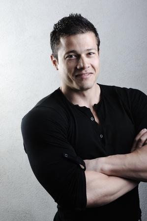 sportsmen: Elegant young handsome bodybuilder man with clothes on
