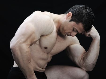 The Perfect male body - Awesome bodybuilder posing photo