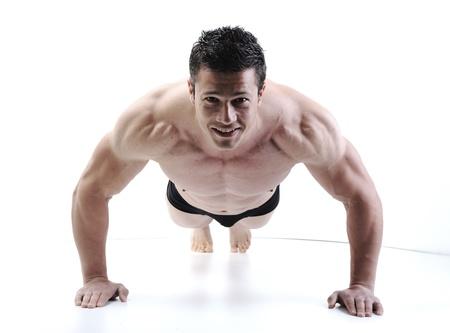 The Perfect male body - Awesome bodybuilder posing Фото со стока