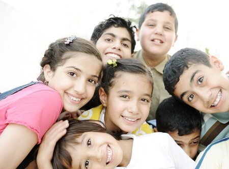kid friendly: Horizontal  photo of children group,  friends smiling outdoor, boys and girls closeup