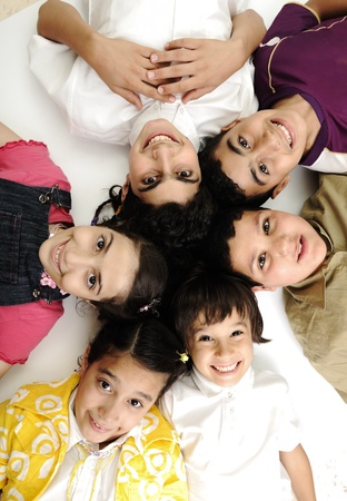 Vertical  photo of children group,  friends smiling isolated on white, boys and girls closeup photo