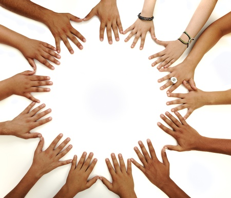 diverse hands: Conceptual symbol of multiracial children  hands making a circle on white background with a copy space in the middle Stock Photo