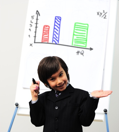Little kid  drawing a  diagram on a whiteboard, future presentation photo