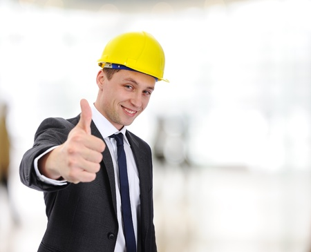Happy young  architect with thumb up indoor photo