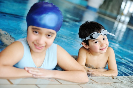 Children in swimming pool learning swimming. Sport. photo