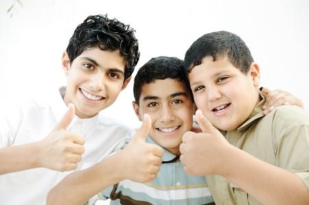 Three boys saying OK with thumbs up photo