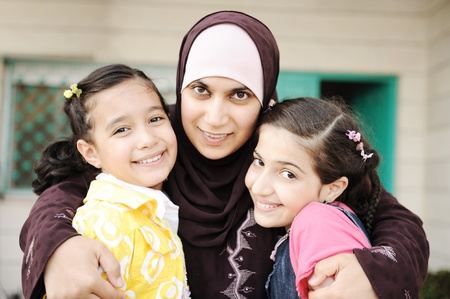 Muslim arabic mother with two daughters, love and care photo