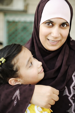 learning pray: Muslim arabic mother with her  daughter, love and care