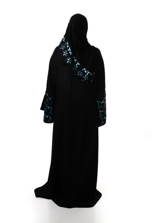 Muslim traditional woman, clothes from back, isolated photo