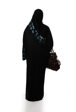 cloak: Muslim traditional woman with shopping bag, clothes from back, isolated