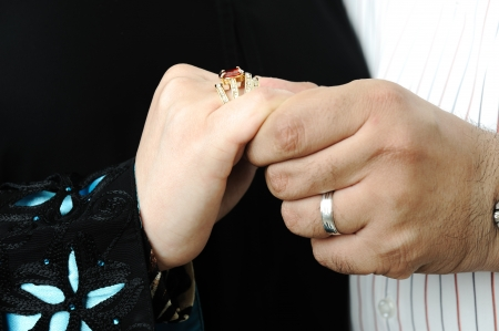 Wedding Day Bride and Grooms hands With Rings photo