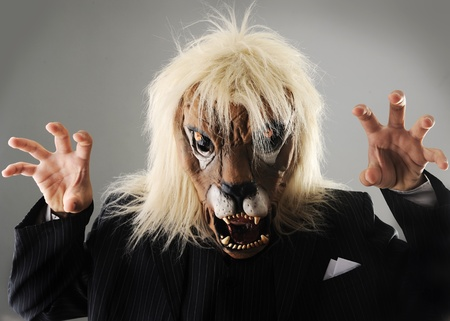 possessive: Portrait of monster boss businessman with face of lion Stock Photo