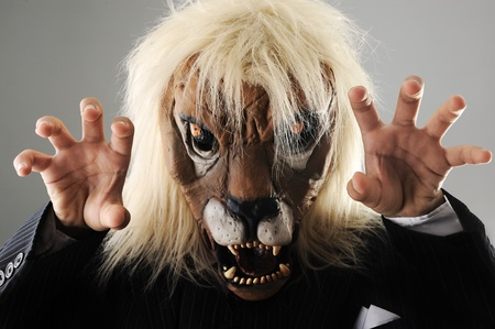 miserly: Portrait of monster boss businessman with face of lion Stock Photo