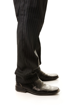 Leg man in a black suit, standing, isolated on white photo