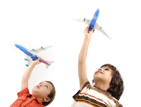 happy kids: Two boys with airplains in hands