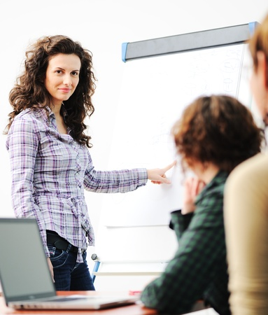common room: Female executive making  presentation to her colleagues in modern enviroment Stock Photo