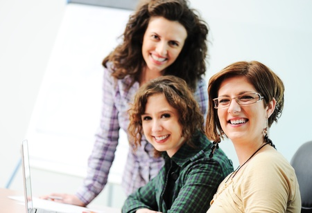 While  meeting, group of young women working together on the table Stock Photo - 10585722