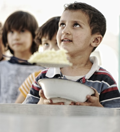 food distribution: poverty kids Stock Photo
