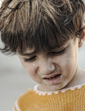 Portrait of poverty, little boy with sad look photo