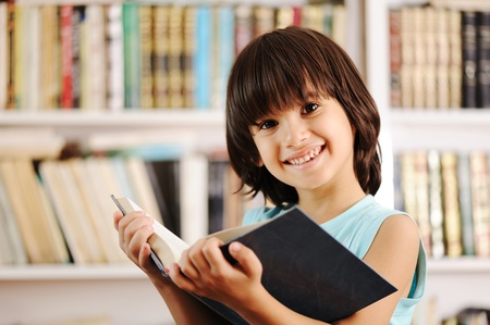 Kid with book in library photo