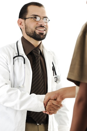 Young adult doctor shaking hand of patient and smiling photo