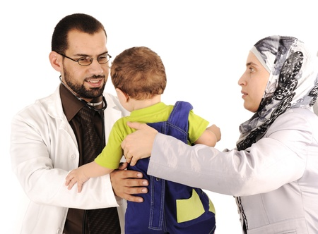 muslim baby: Doctor examining little baby boy Stock Photo