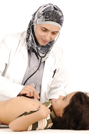 stethoscope boy: Muslim female doctor in hospital examining a little boy Stock Photo