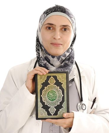 taking medicine: Doctor holding Koran, solution for you, closeup Stock Photo