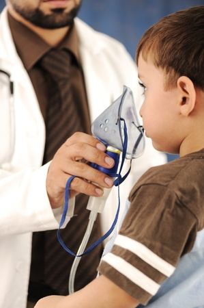 asthma: Doctor, child, inhaler mask for breathing, hospital