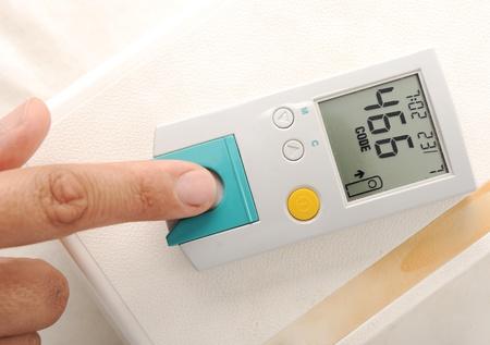 poking: Diabetes patient measuring glucose level blood test