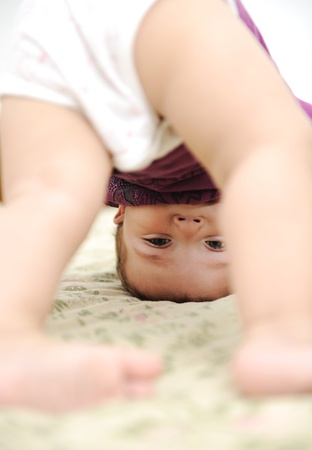 naptime: Baby boy playing upside down in bedroom