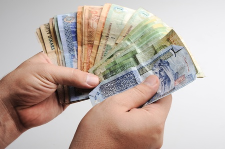 numismatic: Counting arabic money in hands