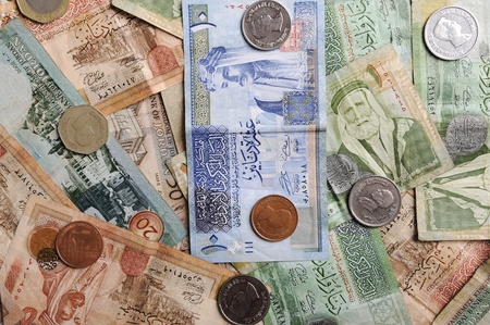 Arabic  banknotes and coins photo