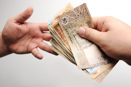 arabic currency: Giving money