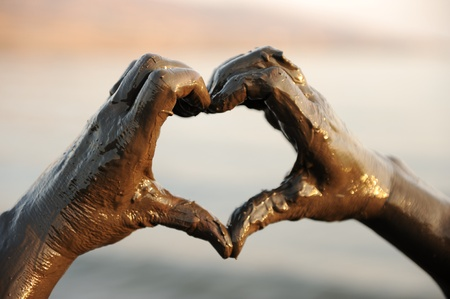 clean heart: Heart shape, hands with spa mug on
