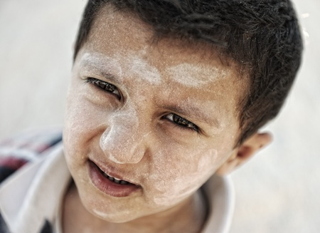 despaired: Portrait of poverty, little poor dirty boy, closeup