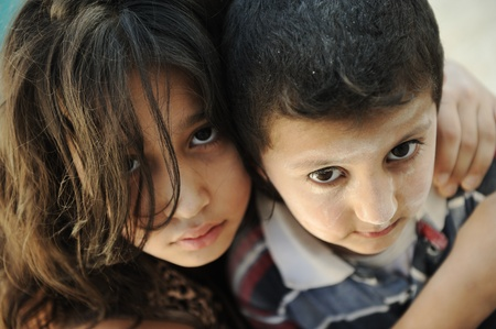 middle eastern families: Little dirty brother and sister, poverty , bad condition