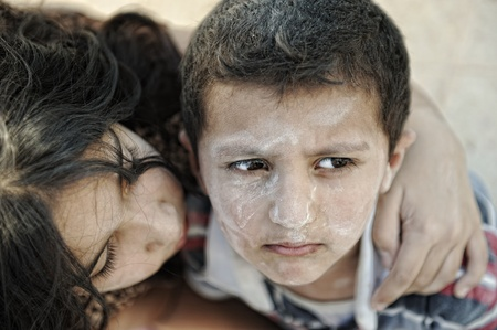 humanitarian: Little dirty brother and sister, poverty , bad condition