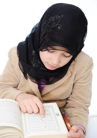 koran: Muslim girl learning, back to school Stock Photo