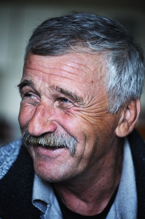 60 70: Common elderly positive man with mustache, happy smiling