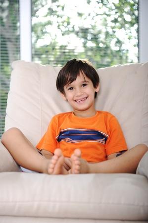 Happy children sitting at home, indoor photo
