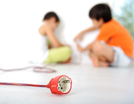 Dangerous game, children experimenting with electricity Stock Photo - 10873792