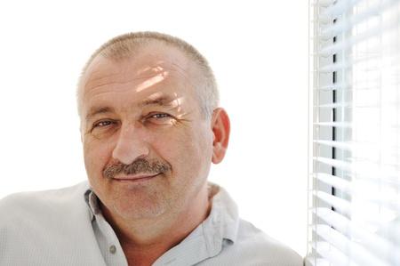 age 60: Senior man indoor