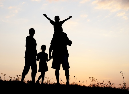 Silhouette, group of happy children playing on meadow, sunset, summertime Stock Photo - 10873807
