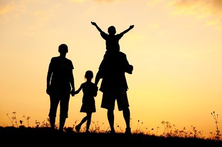 Silhouette, happy children with mother and father, family at sunset, summertime Stock Photo - 10873947
